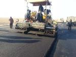 Laying the asphalt concrete mix