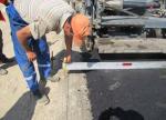 Проверка толщины слоя укладываемого нижнего слоя покрытия из горячей пористой крупнозернистой асфальтобетонной смеси h-10см.