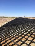 Photo No.2 Placing of geogrid and geotextile at section SP 925+00-SP926+20 on right side of the road