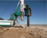 Well drilling under driven pile on interchange